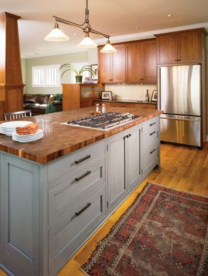 grey island with butcher block/wood counter