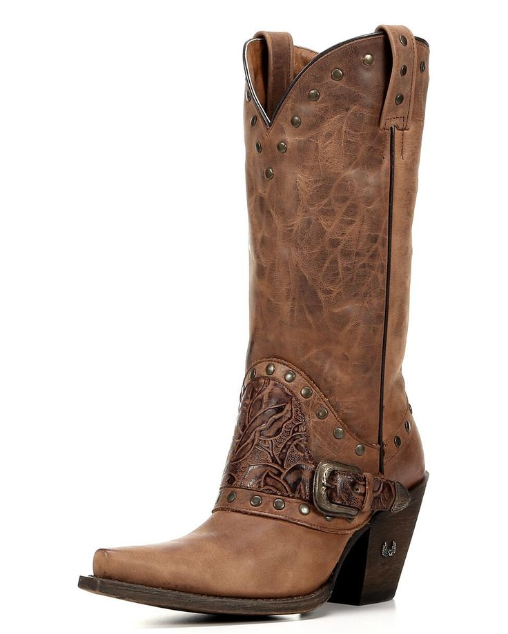 The Angelica Floral Buckle Boot by Eight Second Angel is full of cowgirl details. In this beautiful western boot, brasstone studs dot the collar and pull straps. The saddle showcases seductive floral embossing and even more studs. With its outspoken textures and fine craftsmanship, this women's cowboy boot takes your look to the next level.  Eight Second Angel's cowgirl boots for women are handmade by skilled leather craftsmen. Stitching not only adds beauty, it also helps the leather keep…