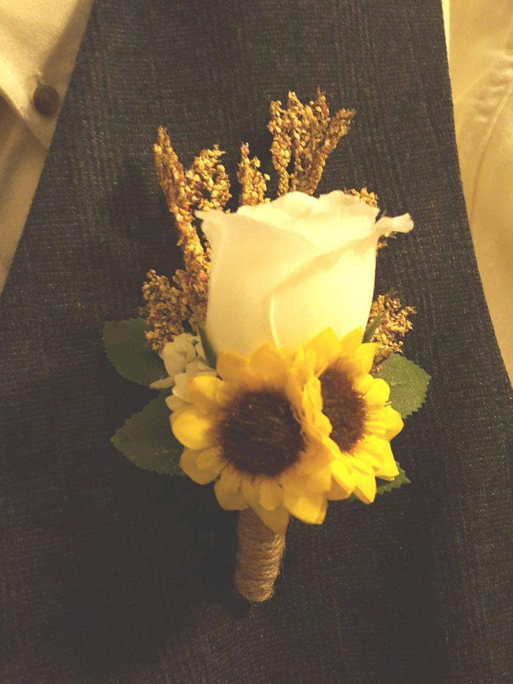 This rustic boutonniere is perfect for your groom or groomsmen on your wedding day! Silk flowers used so that you can preserve the memory forever! This piece features a single rose and two sunflowers with wheat and babys breath accents, as well as natural jute twine.