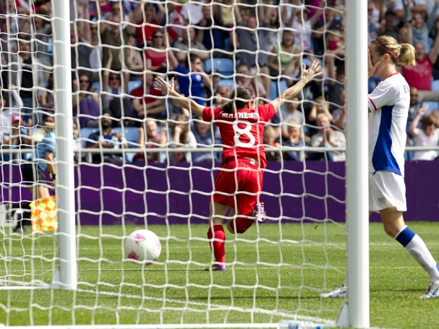 Canada's Diana Matheson, center, celebrates his goal against France during their bronze medal women's soccer match at the 2012 London Summer Olympics.