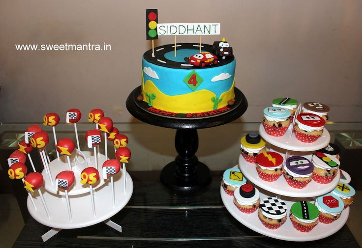 Disney Pixar Lightning McQueen cars theme dessert/sugar table with designer cake, cupcakes and cake pops for kid's birthday at Baner, Pune