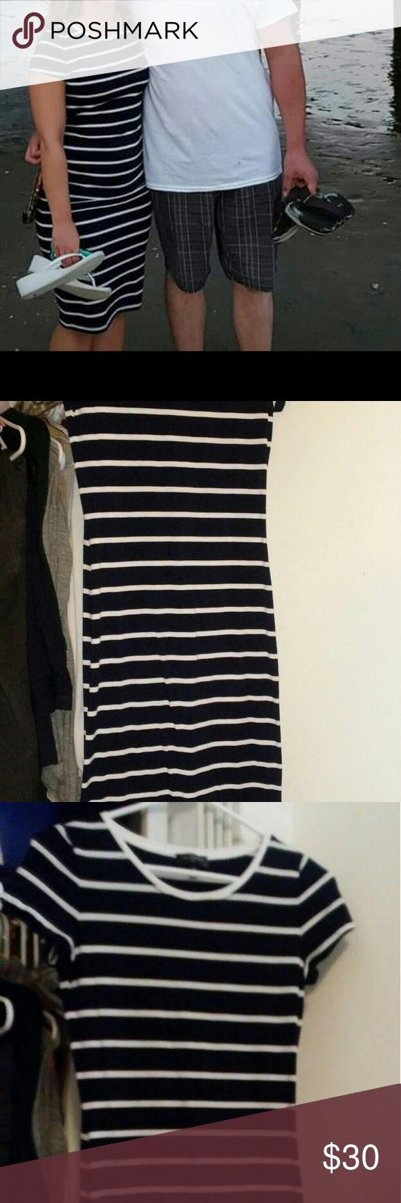 Navy striped petite midi dress Form fitting. Worn once and in great condition. Size xsmall petite but is very stretchy material so would fit anywhere from size 2-8. (For reference I am 32-26-38 & 5 ft tall. The dress is a little tighter around my hips where I am most curvy but not too tight. The dress is well made from The Limited and falls a little below my knees.) Light weight material and is not see through. The Limited Dresses Midi