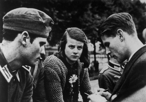 "A 1942 photo of Hans Scholl, Sophie Scholl and Christoph Probst - members of the student resistance group, ""White Rose"". The group distributed pamphlets across Germany appealing to the public's sense of moral duty, calling for resistance to the Nazi dictatorship, and demanding an end to the war.    Sophie would be caught and reported to the Gestapo on the 18th of February, 1943 at Ludwig Maximilians University. All three would then be sentenced 5 days later and beheaded.   George Witt"