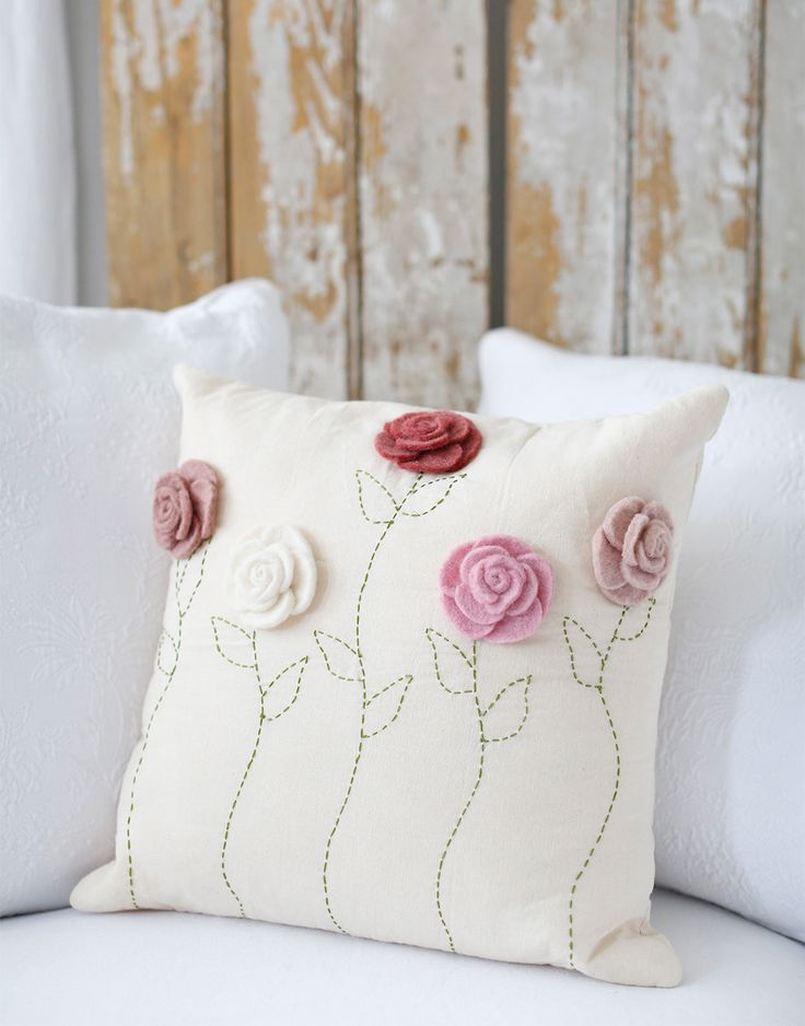 "- Description - Artisan - Artisan Photo - Hang Tag Felt roses blossom atop a linen pillowcase that's finished with hand-embroidered stems. * Hand wash * Approximately 16"" x 16"" * Design on Front * Pil"