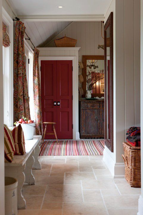 Shiplap, vintage doors, and farmhouse bench in cozy entry of Sarah Richardson farmhouse on Hello Lovely