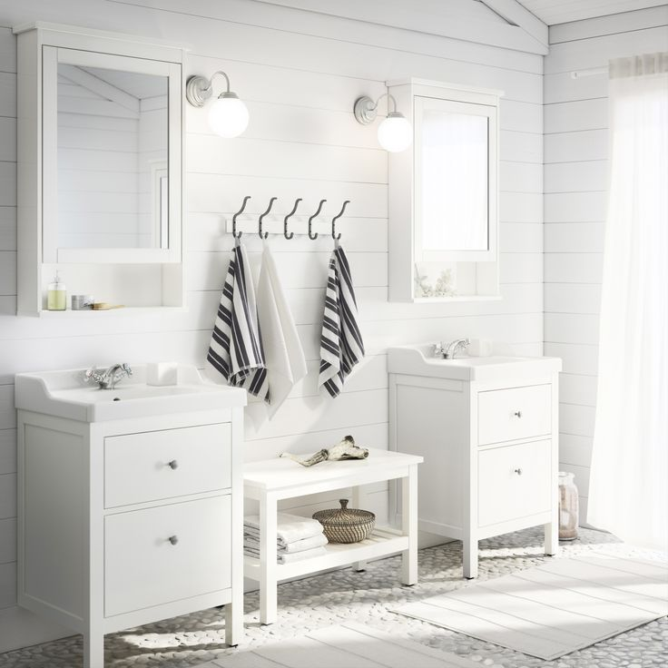 White bathroom in the coming IKEA catalog 2014. I like the stone floor.