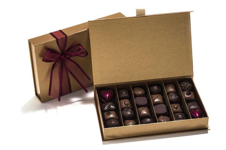 Milk and dark Valentine's chocolate assortment in a medium decorative ribboned gold presentation box.