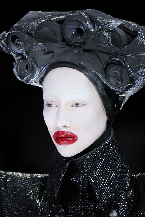 Alexander McQueen, this would go very well for the queen of hearts, the red lips would go and not having any hair on show works really well