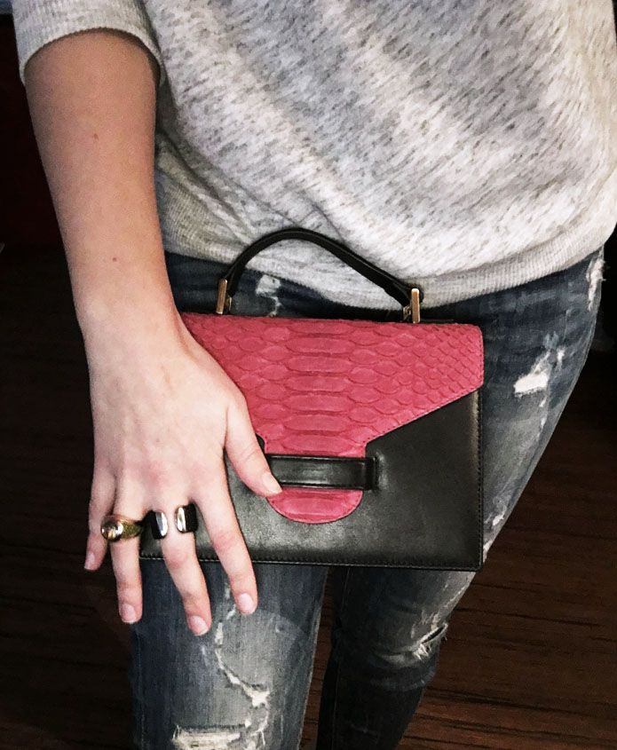 You can see our new Suzy bag with black calf leather and python leather in rasberry matt. As well you can see the sunrise ring and our BA15 ring.