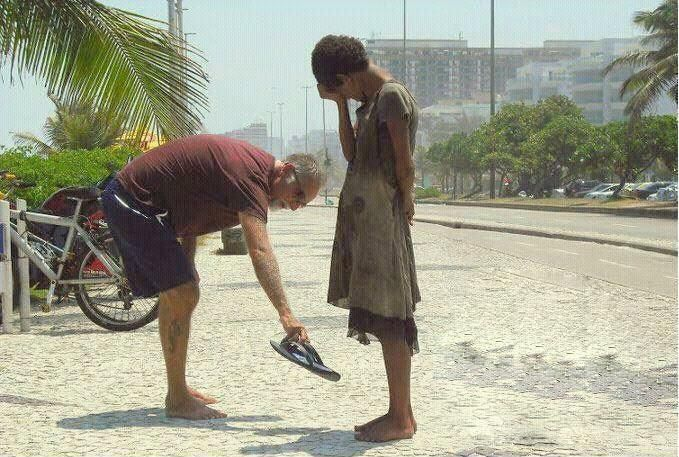 A man giving his flip flops to a homeless person. Such gratitude over something cheap. <3