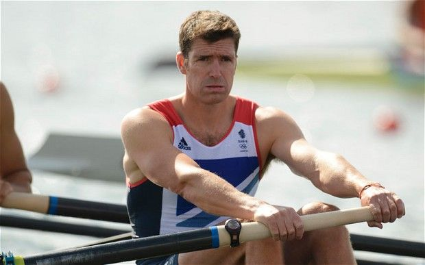 Britain's Greg Searle rows during the men's eight repechage