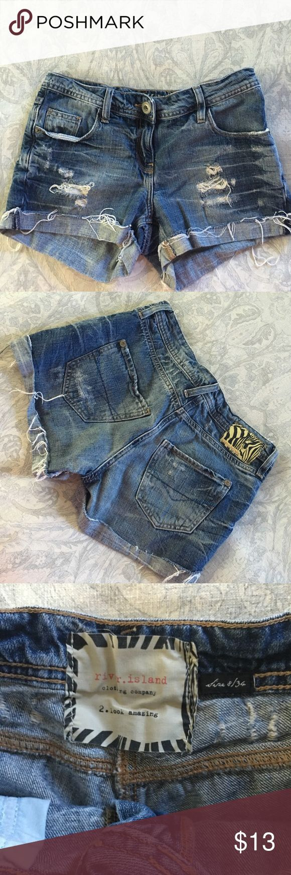 River Island Dark Denim Distressed Cut-Offs River Island dark denim distressed cut-off shorts. Tag says Euro size 34, UK size 8 - but I marked a size 2 because they'd fit a size 2 best (I'm typically a size 0 or 2). Shorts were purchased in Ireland, they're in gorgeous like-new condition. River Island Shorts Jean Shorts