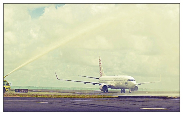The inaugural flight for Virgin Samoa lands at Faleolo International Airport in Apia Samoa. The Boeing 737-800 (ZK-PBF) named 'Tapu'itea' is greeted by the traditional water cannon salute, used for aircraft on their first flight.