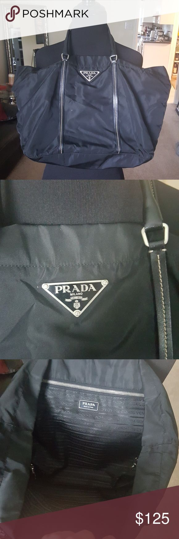 Authentic black Prada tote bag 100% authentic Prada nylon bag with inside zipper and Prada logo lining on the inside. Bag can be cinched with the hooks seen in picture 4 to bring the sides in. Clean interior, and in all over great shape. Bag is on a size 6 dress form. comes from smoke-free home Prada Bags Totes