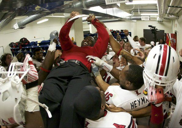 U of L football Coach Charlie Strong gets the victory ride of his life !