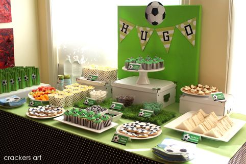 Sports Party: Love the fake grass mat, and popcorn in the paper cups instead of popcorn holders, and cupcakes in the referee-look cupcake cases