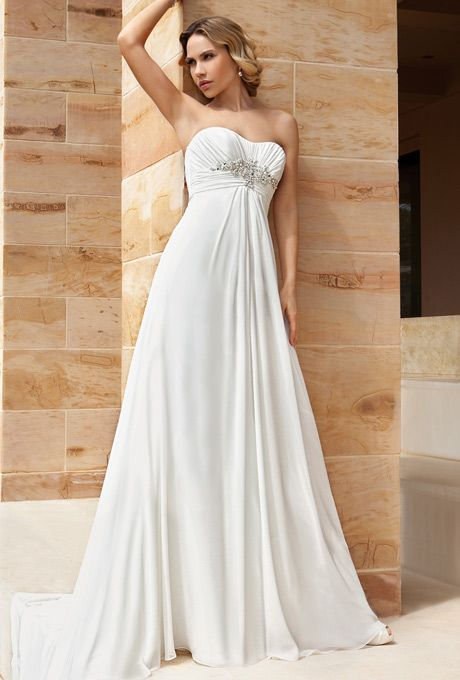 Brides: Demetrios - Destination Romance . Chiffon, strapless gown with a soft sweetheart neckline, and empire ruched bodice embellished with beaded motif. A-line skirt features a chapel train.
