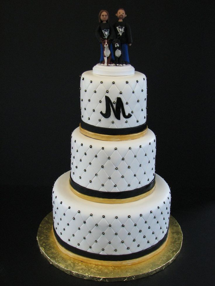 Pittsburgh Penguins Themed Wedding Cake This was a three tiered wedding cake made for a Pittsburgh Penguins themed reception.