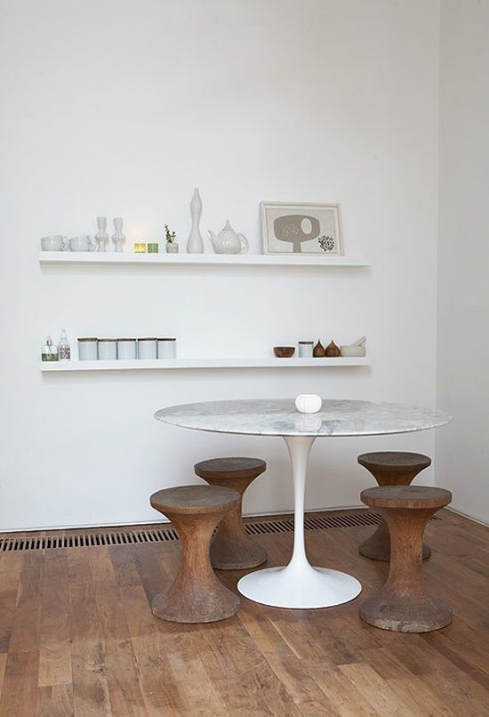 The Saarinen table. One of my favorites. LOVE the little wood seats and the simple floating shelves too!