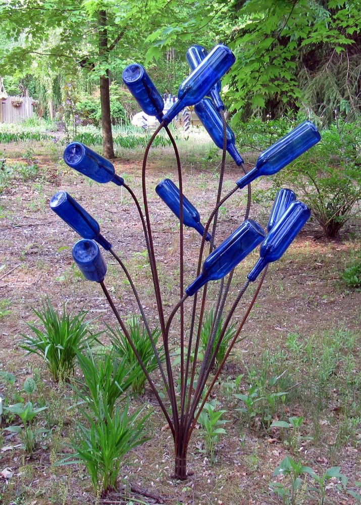 Bottle Trees were put near the entrance to a house, so spirits did not enter with you. The spirits would become mesmerized by the play of the sunlight thru the colors of  glass, and be trapped inside the bottles. the spirits are trapped in the bottles & said to be destroyed when the sun comes out the next morning. This is what I need to do with my next installment of blue Vodka Bottles, right?