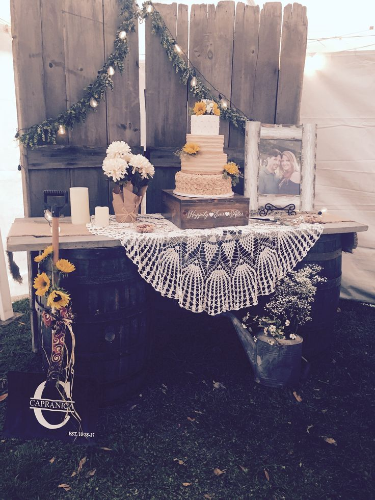 Rustic doors for the back drop of this sunflower / fall wedding cake! I love the lights and custom stand too! Cake Crumbs Limited, Morton, IL