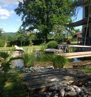 Une piscine écologique accolée à une maison  - Marie Claire Maison