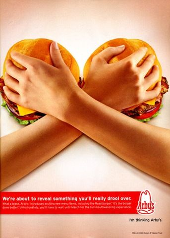 12- Places that sell food use women and their bodies as a selling point as they objectify the women. Arby's places two hamburgers with a women's hands grabbing them as if they were her breasts.