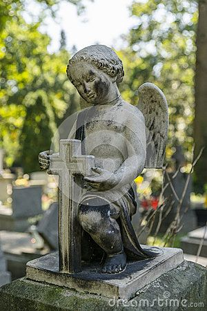 Cherubin With cross on the Tomb in Rakowicki cemetary in Krakow.