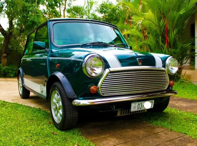 Car Morris Mini cooper  For Sale Sri lanka. Mini Cooper for sale 1300cc Efi (tune up done recently) Triptonic transmission A/C Teak interior Original tartan version YOM-1995 New japan tyre set(toyo) and new battery Original carrozzeria 7cd changer  No corrosion 100% body condition and new paint 100% running condition  Clear documents 14.75 negotiable after the inspection Contact- (077) 169 3085