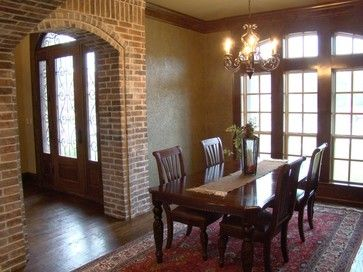 A Bright Dining Area Just Off The Entry Foyer With Interest Added By Brick
