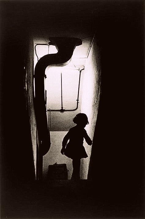 Ikko Narahara -  The entrance of a Warship Island (Gunkanjima) apartment, night view, 1954-58.