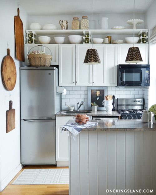 DIY Project: Beautifying Track Lighting with feathers, love the cutting boards and this tiny kitchen!