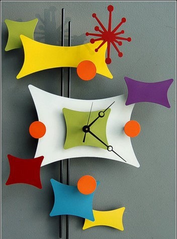 "50s style ""atomic"" clock. I love the cheerful color and collection of shapes."
