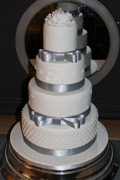 Chic white and silver wedding cake..I would use tiffany blue ribbon