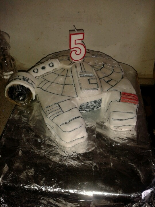 The Millenium Falcon. Making novelty cakes is not my forte...but my son wanted this sooooo much I had to try. I hated making it so much it nearly flew for real!!