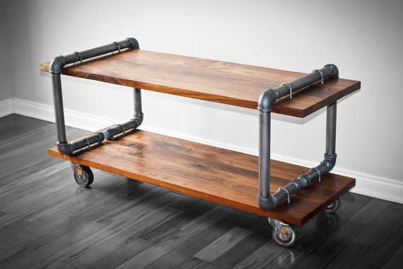 Industrial Cast Iron Pipe and Black Walnut Table TV Stand Media Table     $1,000 on Etsy