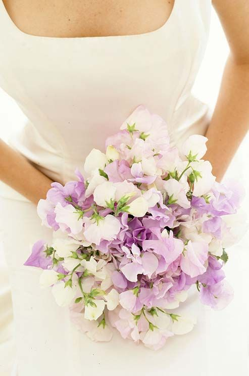 Shades of purple add depth to a soft, unstructured bouquet of sweet Peas.
