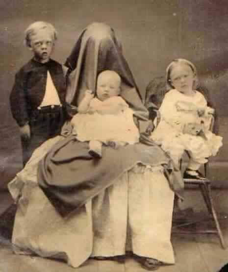 """Hidden Mother"" was a 19th century portrait trend where mothers, who were basically dressed a ""ghost,"" would hold their young children still while being photographed. The end result was, well… haunting and creepy."