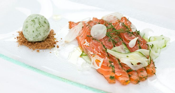 The succulent flavors of Dijon mustard-cured gravadlax are lifted to new heights with a surprise partnership of cucumber, fennel and lime sorbet. Recipe by Chef Galton Blackiston.