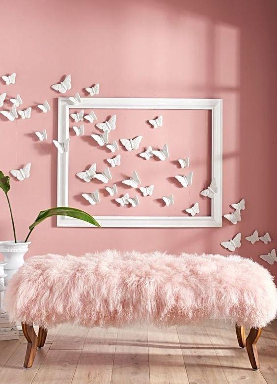 Α hot pink wall with butterflies and a pink fur bench look chic together