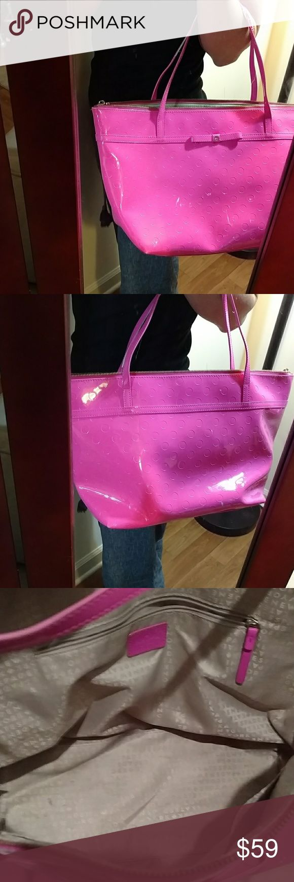 Kate spade bag Sale....Beautiful bright pink oversized kate spade bag. 100% authentic but in used condition. Does have a couple white marks and bottom has a stain. Handles are fraying from wear but still has life. I have marked to sell because of use.   Shoulder drop is 8 inches. Bag is 19 inches wide and 10 inches deep. Has 2 pouches on one side and a zipper slot on other side kate spade Bags Satchels