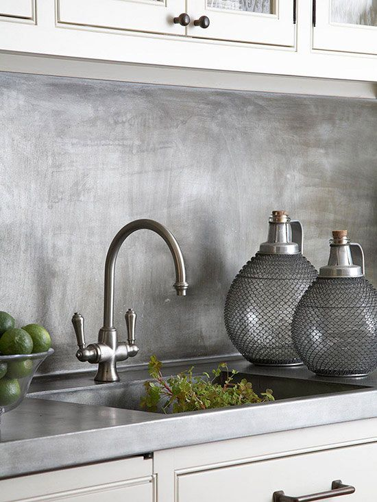 Brushed Metal backsplash...I think I'm in LOVE! I bet it is crazy easy to clean this too. I bet Wanda could make this for me even.