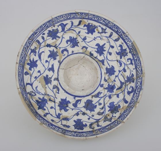 Footed dish with a round depression in center and floral decoration  Vessel  Turkish  ,  17th-18th century  Ottoman Empire, AH 680-1342 / AD 1281-1924  Creation Place: Kutahya, Turkey  Ceramic  7.5 x 14.2 cm (2 15/16 x 5 9/16 in.)