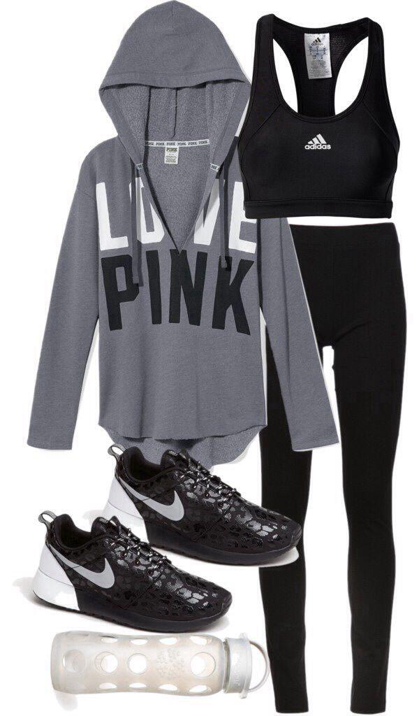 Grey Victoria Secret Pink hooded sweatshirt, black running tights, black and white leopard print Nike Roshe Run shies, black Adidas sports bra
