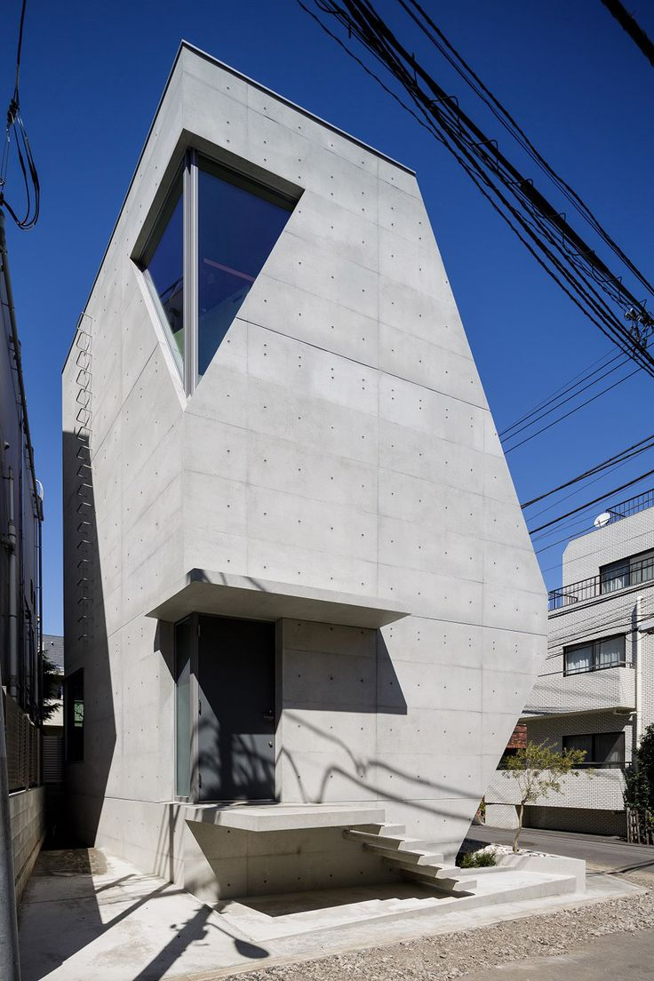 Volcanic ash is mixed into the concrete shell of this angular house in central Tokyo.
