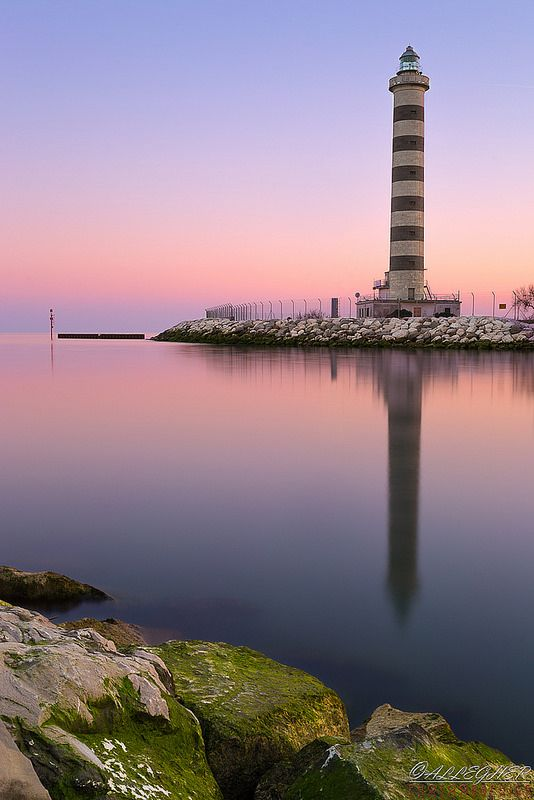 Lighthouse sunset in Jesolo, province of Venice, Italy