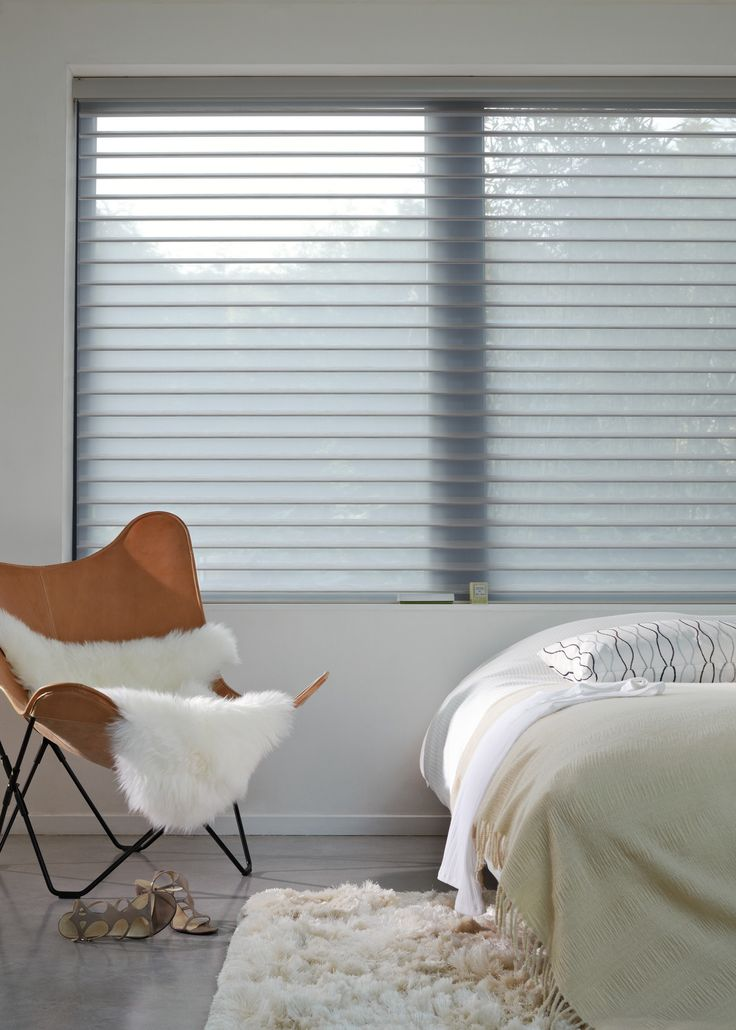 Luxaflex® Silhouette® Shades. Everything in the Silhouette® Shades colour palette says sophistication; soft whites, cool contemporary greys or subtle, natural earth tones – all perfectly complimenting a classic or contemporary interior décor. #Luxaflex #SilhouetteShades #Bedroom #Blinds