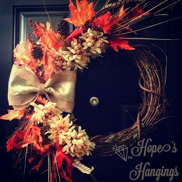 From order to delivery in two days!  This Fall foliage wreath sports all your favorite #FallColors. Red, orange, and yellow leaves are interspersed with sprigs of straw and petite #pinecone accents.  We are in love with the #golden glitter #burlap bow that ties it all together.  Order today!  www.facebook.com/hopeshangings