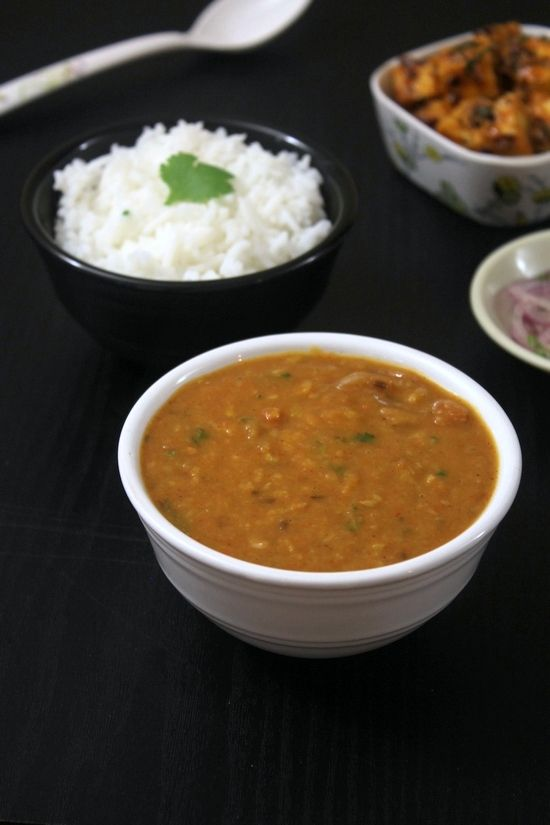 Toor dal recipe or arhar ki dal – split pigeon peas are cooked Punjabi style. Boiled tuvar dal is cooked with onion, tomato and spices and topped with butter.