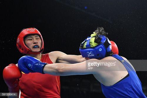 China's Li Qian (red) fights Brazil's Andreia... #apoldudesus: China's Li Qian (red) fights Brazil's Andreia Bandeira (blue)… #apoldudesus